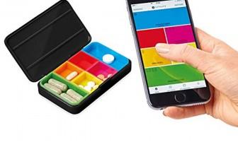Voorbeeld smart pill box en app op mobiel